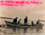 "Four people in a boat, Fort Chippewyan. A note on the front reads: """"His Reverend and..."