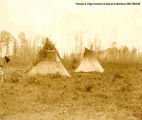 Two teepees in a field, [Alberta].