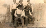 Portrait of five Indian men, three standing and two seated, [Alberta]. Note on the back reads:...