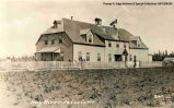 "A large building with a flag on the roof, Hay River. Note on the front reads: """"Hay..."