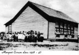 Students of Margaret Carson's class 1939-1940 (grades 1-4), at the original site of the Mission...