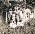 "Portrait of a family, background of bushes and trees, [Alberta]. Note on back reads""..."