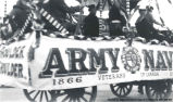 Army and Navy Veterans in a wagon with Canada 1866 on the side, [Alberta].