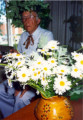 Latvian man with Ivy Head Wreath, Daisies and Traditional Vase
