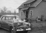Valdis Auzin's with family car and Pigeon Lake homestead
