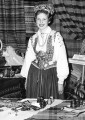 Girl in Latvian traditional dress with Cultural Artifacts table