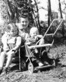 Baiba Berzins nee Kundrats with her mother and baby brother Uldis in baby carriage
