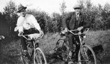 Karl ( Charlie) Deering and person on bicycles